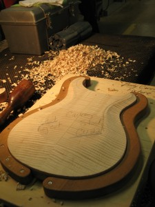 prs electric guitar body just after being roughly carved before hand work begins. Black Bedroom Furniture Sets. Home Design Ideas